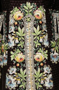 Detail rear view, court coat, France or Spain, 1790s with later alterations. Voided black velvet, embroidered with floral naturalist flowers and lace effects with tulle edgings.
