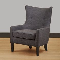 A thick, comfortable cushion lets you sink into this dark gray linen lounge chair. Using a modern take on a classic design, this chair adds sophistication to any contemporary decor. A strong birch fra