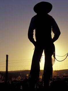Cowboy Silhouette, Ponderosa Ranch, Seneca, Oregon.  Photographic Print  by Darrell Gulin