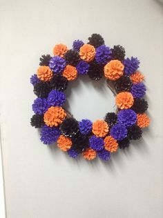 A personal favorite from my Etsy shop https://www.etsy.com/listing/246986336/halloween-pinecone-wreath-halloween