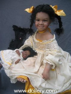 Jamie~  GRS says:  I LOVE her!  Super expression, lots of personality.  The doll artist is Susan Krey, I believe.