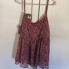 Cute Torrid babydoll top! It's a very flowy top! It's comfortable and breathable. The top was way to big for me unfortunately. It's a cute floral print as well. It's a size 3, slightly shorter in the back than the front torrid Tops Tank Tops