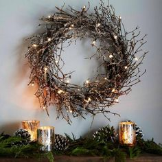 Battery-powered LED lights and glitter turn a twig wreath from West Elm into holiday art.