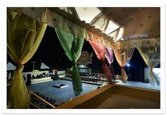 Guest enjoying cultural programme at Camp e Khas, Jaisalmer. India.