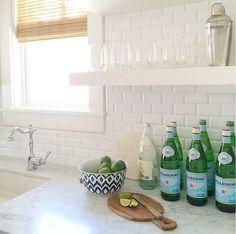 Kitchen Prep Sink With Floating Shelves And White Tile Backsplash Kitchen Backsplash Is Beveled White Subway Tiles