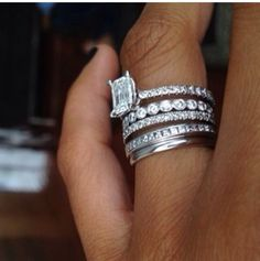 4 stacked wedding bands with emerald cut