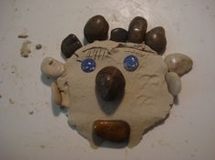 """After using clay at the river and using leaves and stones in it this activity really caught my eye. I love the idea of incorporating loose materials and clay, opposed to """"play dough"""" and some plastic tools. Having children explore how stones and glass can affect the clay and their creations is so much more open ended than some plastic knives."""