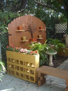 Cinder block wall planter - I love this! Perfect for between the carport and patio area.