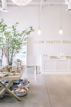 Touring The Picture-Perfect Plum Pretty Sugar Retail Space Table - turn into narrow shelves for ingredients in back room hanging glass pendant lights Hair Salon Interior, Salon Interior Design, Boutique Interior, Studio Interior, Retail Interior, Salon Design, Boutique Design, Boutique Spa, Design Design