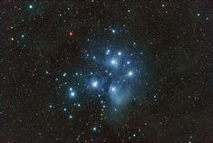 The star cluster of the Pleiades is one of the brightest and nearest open star clusters in the sky. Also known as the Seven Sisters, the brightest stars are young blue giants, all younger than 100 million years. In about 250 million years, gravitational forces will tear the cluster apart and the stars will scatter. There is about 3000 stars total in this cluster which is only about 13 light years across. It's roughly 400 light years away in the constellation Taurus.