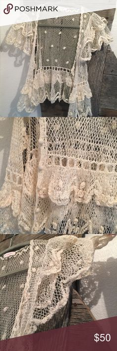 Betsey Johnson crochet shrug This is beautiful with so much detail. Cream. Very delicate and light. Bought this a long time ago and wore it one time. Perfect condition. Betsy & Adam Sweaters Shrugs & Ponchos