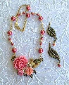 Here is a beauty from Jann Tague of Clever Designs at Facebook....she's thinking SPRING!  Leaves and components can be had at http://www.bsueboutiques.com