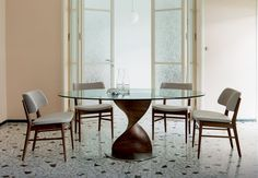 This Elika dining table has a unique decorative leg creating an attractive design.