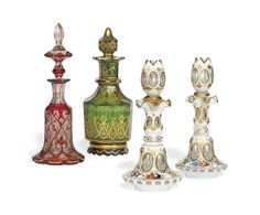 A COLLECTION OF BOHEMIAN CUT-GLASS BOTTLES -  MID-19TH CENTURY