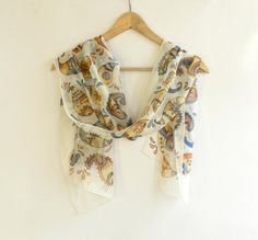 Paisley hand painted silk scarf . Brown and blue paisley ornament . Made to order.