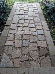 sidewalk using old, broken stones and pea gravel