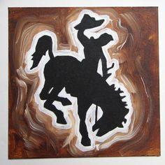 Wyoming cowboy buckin' horse