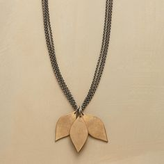 """ETERNAL LEAVES NECKLACE--The delicacy of new leaves is captured in solid bronze in this three-leaf necklace. Matte luster finish complements the triple-strand, oxidized sterling silver chain. Bronze toggle closure. 28""""L."""