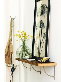 Would be nice for our back entryway from garage. Love the print and shelf.