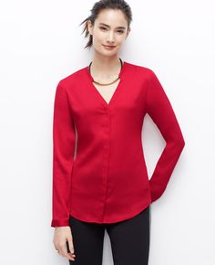 """We're loving the wear-now wow factor of this refined crepe blouse, smartly dressed in the season's most sought-after shades. Add a cami beneath for more coverage. V-neck with collar band. Long sleeves with button closure. Hidden button front. Shirttail hem. 27 1/2"""" from center back neck to hem."""