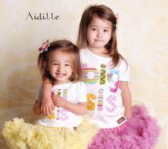 Big Sister Shirt Applique Big Sis Girls Short Sleeved Shirt. $29.50, via Etsy.