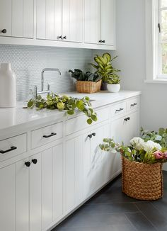 White tongue and groove on the cabinetry + inset cabinetry + white Butlers Pantry cabinets + butlers pantry layout + herringbone floor tiles + penny tile backsplash | Evars Anderson