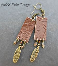 Brown leather, gold feather and wood beaded tassel earrings. Metal, wood and leather jewelry #JewelryClean