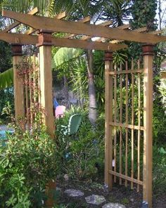 What is a Garden Arbor Used For?: A wood arbor serves as a transition from one part of the yard to another.