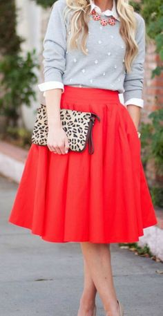 Cluster sweater in lavender with red midi skirt.