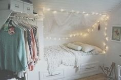 An all-white decorating scheme and lots of lights make what could have been a claustrophobic space seem open