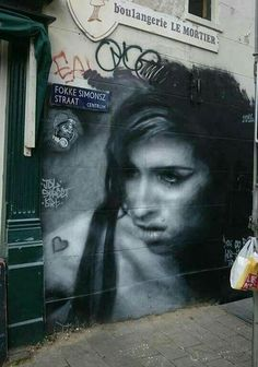 Ami Winehouse Street Art by JDL, located in Amsterdam, the Netherlands