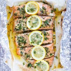 A quick and easy baked salmon recipe that is coated in a butter, lemon and basil sauce, wrapped in foil or parchment paper and then cooked in the oven. It is the best healthy, easy, and low-carb seafo Baked Salmon Recipes, Chicken Pasta Recipes, Fish Recipes, Seafood Recipes, Dinner Recipes, Cooking Recipes, Paleo Dinner, Healthy Recipes, Recipes With Smoked Salmon