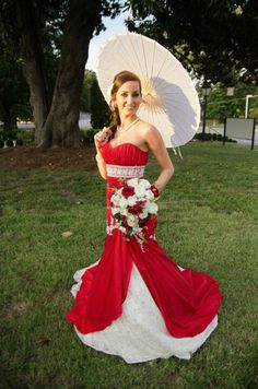 Maggie Sottero Amara Mermaid Wedding Gown. Royal red with gold and ivory detailed lace. Kelli Bill
