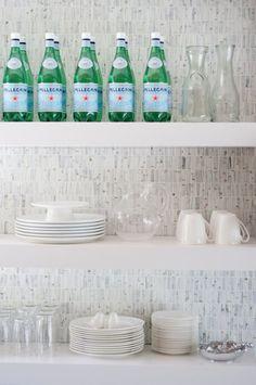 chucky white modern shelves with mosaic tiles backsplash