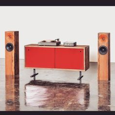 The Fern & Roby credenza, the perfect place to set up your hi-fi system. Seen here with The Beam speakers, The Amp, and The Turntable. We cast everything four blocks from our studio, and use as much reclaimed and recycled material as possible.  #red #reclaimed #recycled #foundry #barnwood #castiron #credenza #minimalist #furniture #speakers #integratedamp #turntable #hifi #stereo #Audio #MadeInRVA