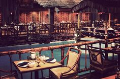 TONGA ROOM & HURRICANE BAR  SAN FRANCISCO, CALIFORNIA  You'd never guess it from its fancy exterior, but deep within the basement of The Fairmont hotel in San Francisco lies one of the best Tiki-style bars around. Open since 1945, the Tonga Room & Hurricane Bar hasn't changed all that much over the years — and that's a good thing. Aside from a classy-looking bar and island-themed tables and chairs, it boasts a lagoon in the middle of the joint that sees periodic rainstorms crop up.