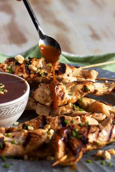 Satay Chicken with Spicy Peanut Sauce from RecipeGirl.com is a quick and easy weeknight dinner that's not lacking in flavor!