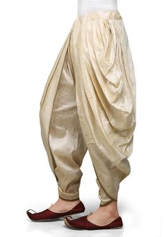 Ideal for auspicious occasions, this Light Beige Art Dupion Silk Dhoti will lend you a stylish ethnic look, while ensuring comfort