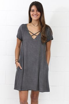 Amazingly soft, mineral washed basic dress featuring a v-neck with criss cross straps and hidden side pockets. Loose, swing fit. Great basic. Available through plus size.