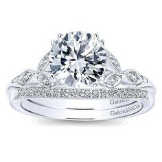 14k white gold .08cttw floral style round diamond engagement ring. This .08cttw mounting features round diamonds in a unique vintage floral style, accenting a 3