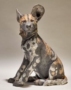 Wild Dog Sculpture | Nick Mackman Animal Sculpture  nickmackmansculpture.co.uk