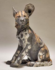 Wild Dog Sculpture | Nick Mackman Animal Sculpture  nickmackmansculpture.co.uk