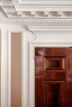great door and hinges. Good way to deal with a low ceiling with a depressed projecting crown - John B. Murray Architect: Apartments