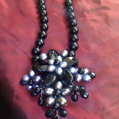 Amazing onyx & pearl pendant This is a stunner from my onyx collection... Brightens up your outfit immediately ... Lots of onyx & gorgeous gray freshwater pearls... Sterling silver hook allows you to set at different length....Love it! Jewelry