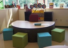 guided reading area with skirted table and ottomans from Target