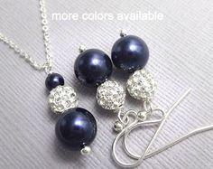 CUSTOM COLOR Swarovski Ivory Pearl and Dark Sapphire Crystal Bridesmaid Necklace, Earring and Bracelet Set  PEARL SIZE: 8 MM. PLEASE SEE SECOND PHOTO FOR SIZE REFERENCE  AVAILABLE IN OTHER COLORS: Please see color chart and kindly note on check-out your color preferences.  Necklace default length: 16 inches. Also available at 18 inches. Comes with 2-inch extender. Please note length preference on check-out.  Bracelet default length: 6.5 inches with 1.5-inch extender. For other lengths…