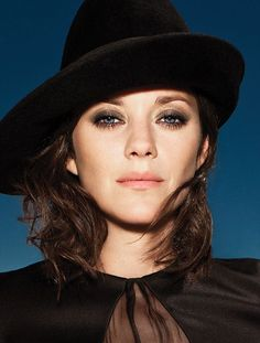 Marion Cotillard, Giorgio Armani hat. Photo by Matthias Vriens-McGrath.