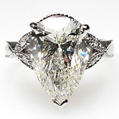 Estate 4 Carat Pear Cut Diamond Engagement Ring Solid 14K White Gold - EraGem... love the butterflies on the sides