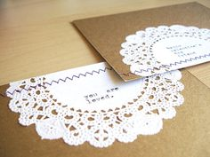 Doily sewn on envelope - sweet!