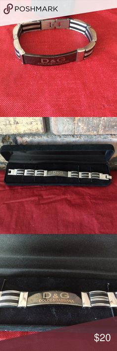 Female/male Dolce&Gabbana bracelet Nice stainless steel bracelet with black lines. In the middle of bracelet is a black link that reads D & G and underneath that it's spelled out. Last pic is of the back of the bracelet. Comes in black box. Can be worn for men or women. Jewelry Bracelets